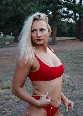 Outdoor boudoir fitness photoshoot of sexy blonde Colorado fitness model Rachel 'gocrazyrachel' Pressler in sexy red lingerie | Denver Fitness Photographer
