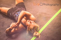 Crossfit girl laying on the floor after a crossfit competition