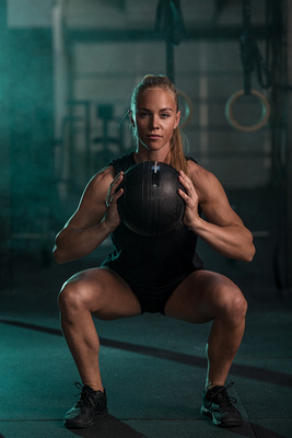 Denver Fitness Photography of a crossfit woman & olympic weightlifting female competitor Kallie Horton doing a jerk lift