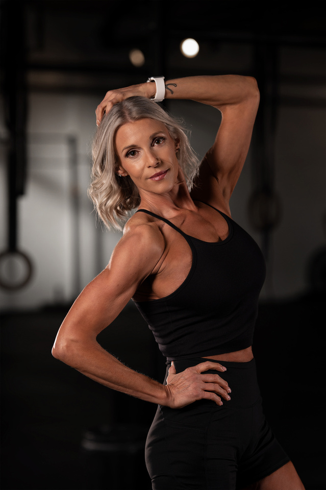 Denver Fitness photography of crossfit girl wearing nike metcons and holding a kettle bell